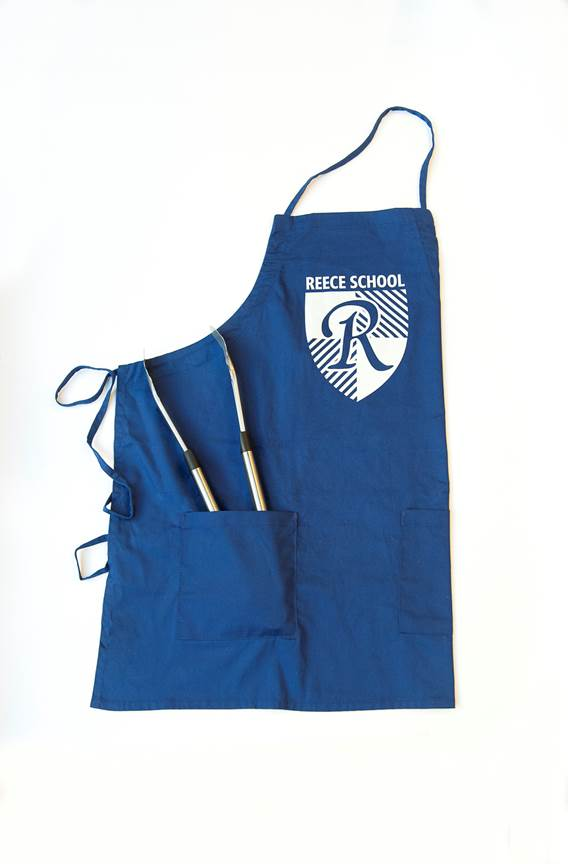 white apron with reece school logo